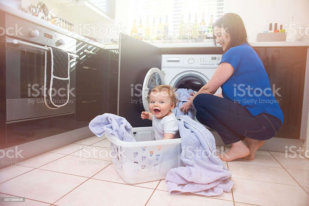 Helping Mummy stock photo