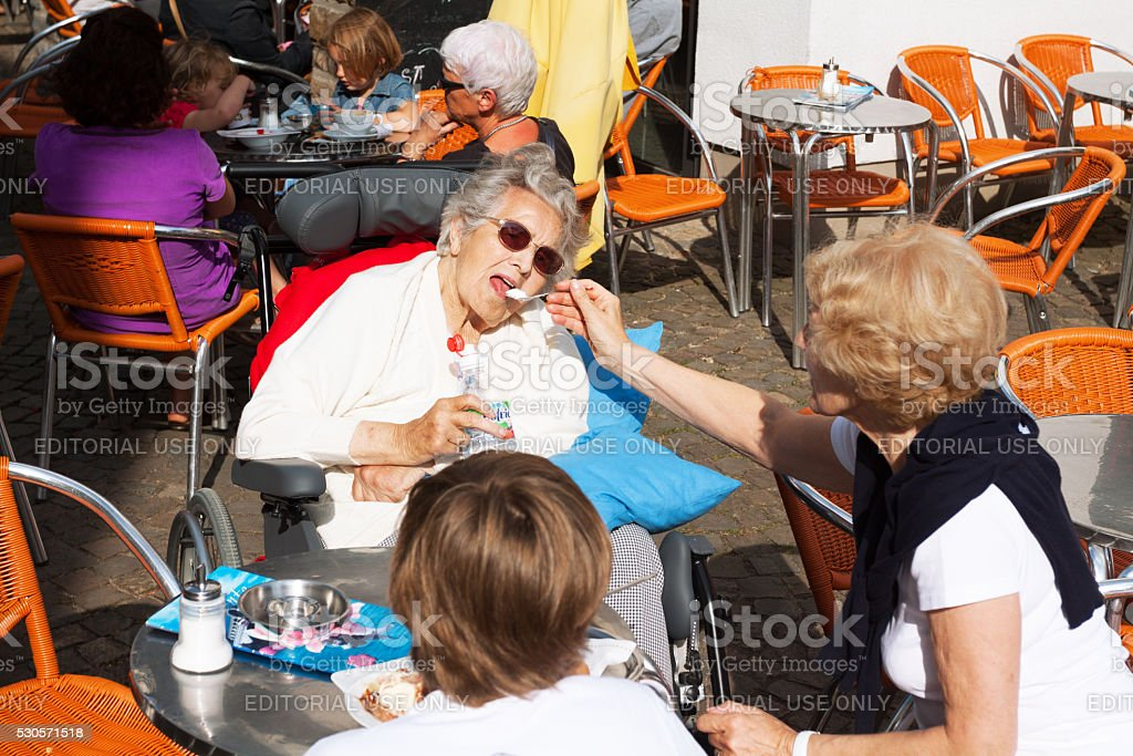 Helping old woman stock photo