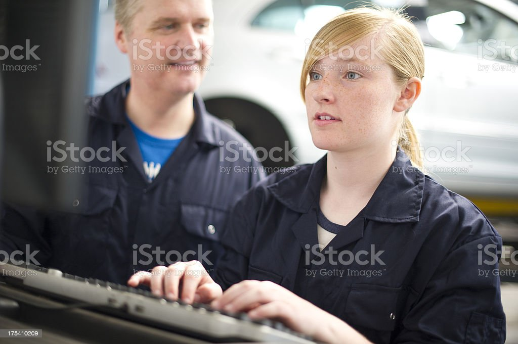 helping out at the garage royalty-free stock photo
