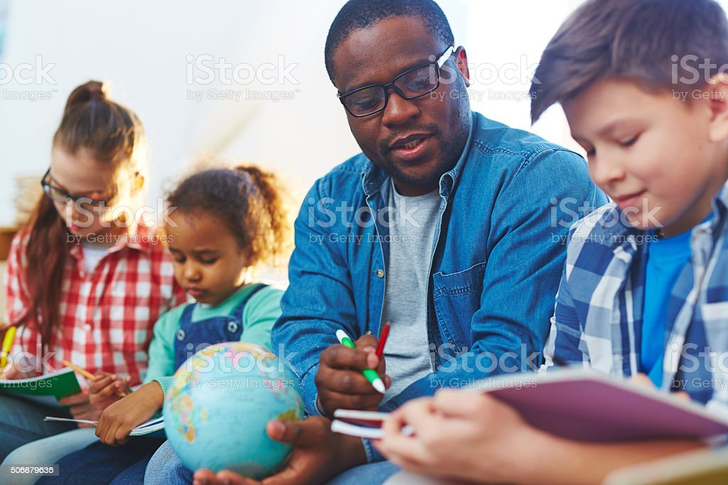 Helping schoolboy stock photo