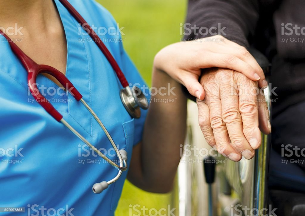 Helping the Disabled stock photo