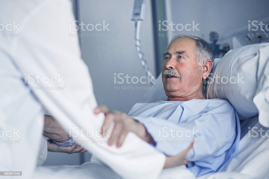 Helping the patient stock photo