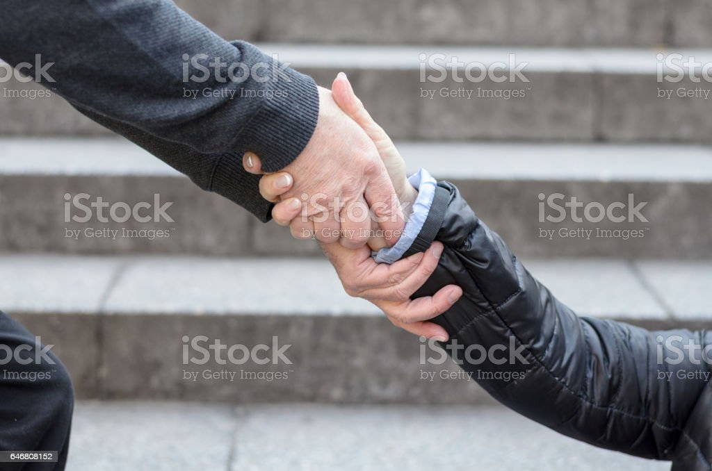 Helping to get up concept stock photo