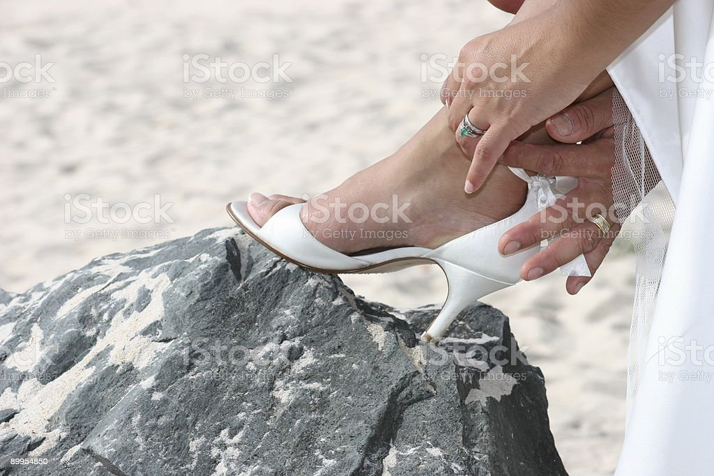 Helping with the Shoe royalty-free stock photo