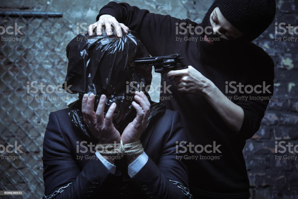 Helpless desperate executive being tortured stock photo