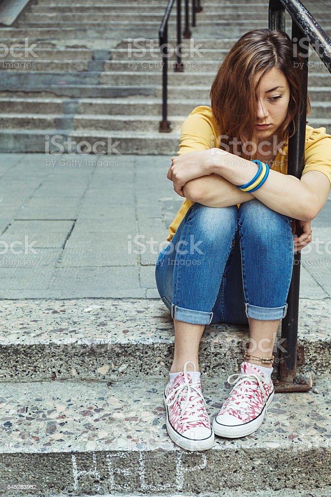Helpless teenage girl stock photo