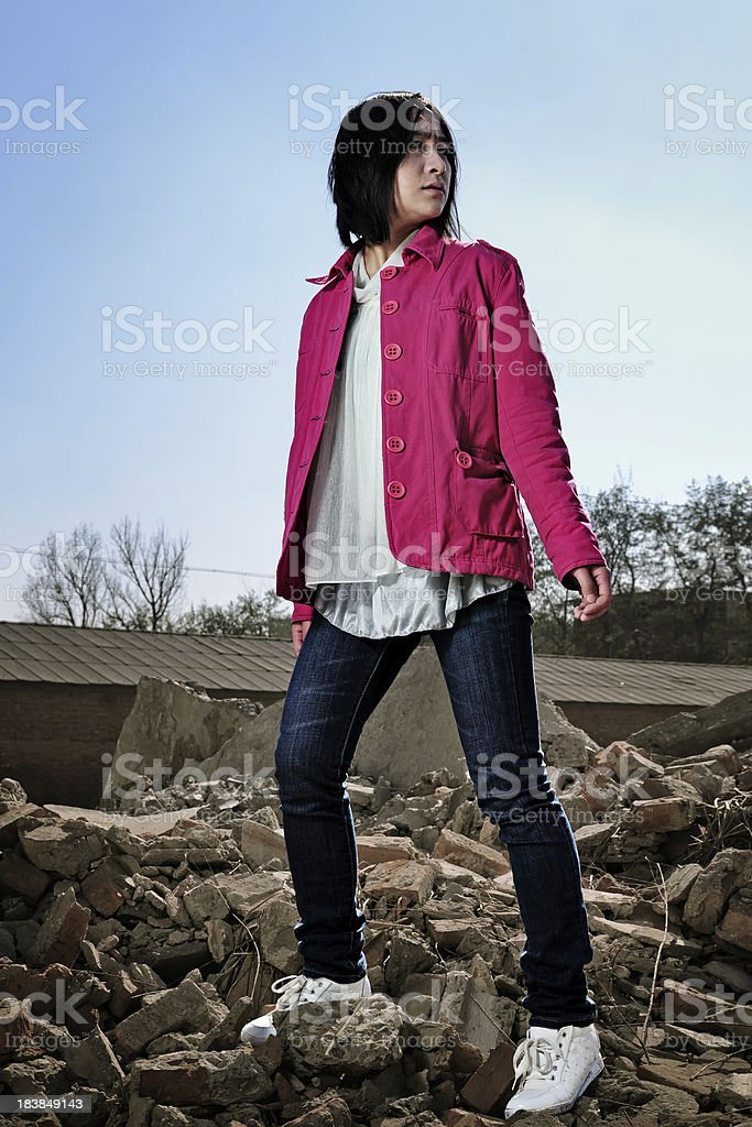 Helpless Woman Standing On Ruins - XLarge stock photo