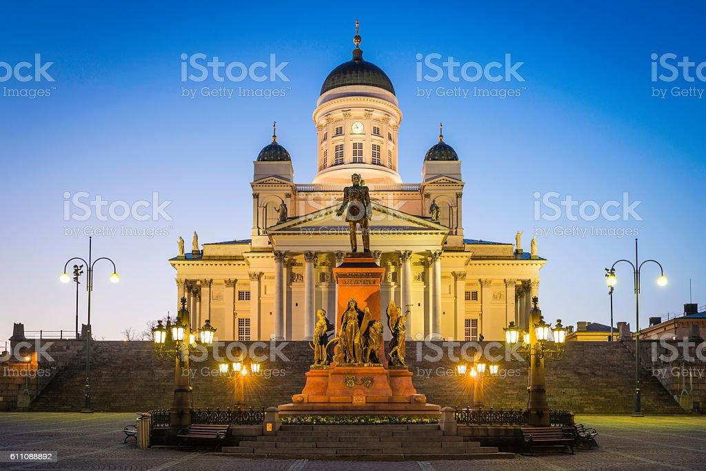 Helsinki Cathedral illuminated at dusk overlooking Senate Square Finland stock photo