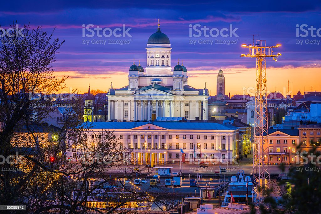 Helsinki Cathedral illuminated sunset overlooking waterfront and City Hall Finland stock photo