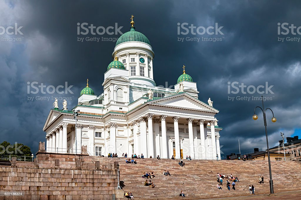 Helsinki cathedral shines bright against threatening storm clouds stock photo