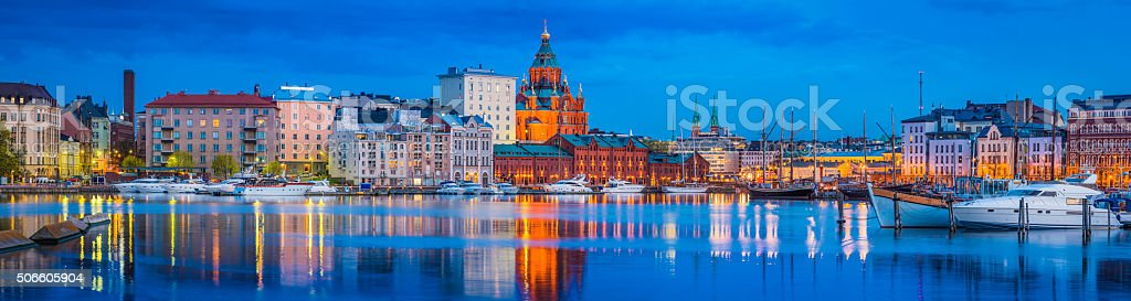 Helsinki harbour Uspenski Cathedral yacht marina illuminated at dusk FInland stock photo