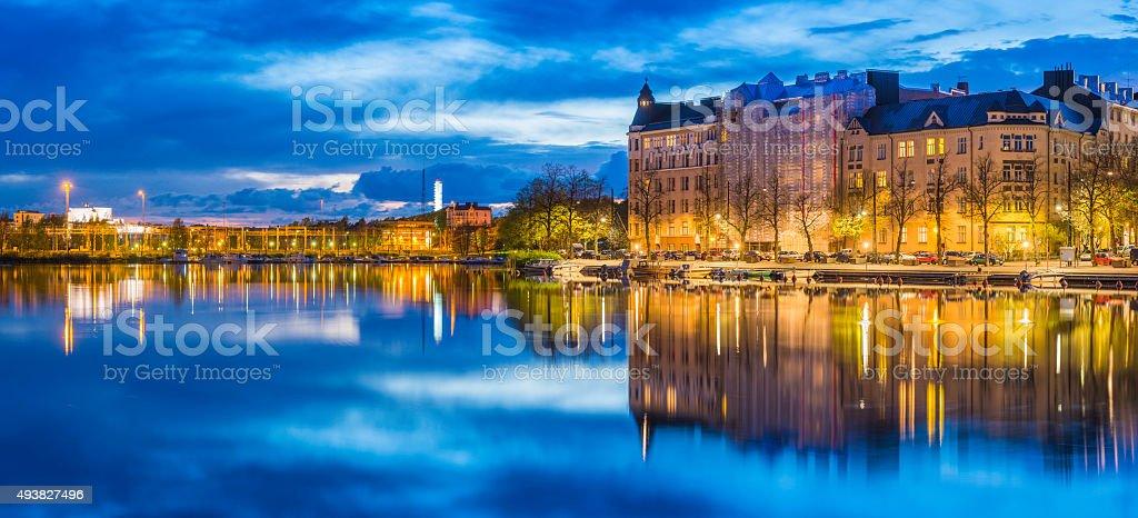 Helsinki waterfront cityscape reflecting in lake at sunset panorama Finland stock photo