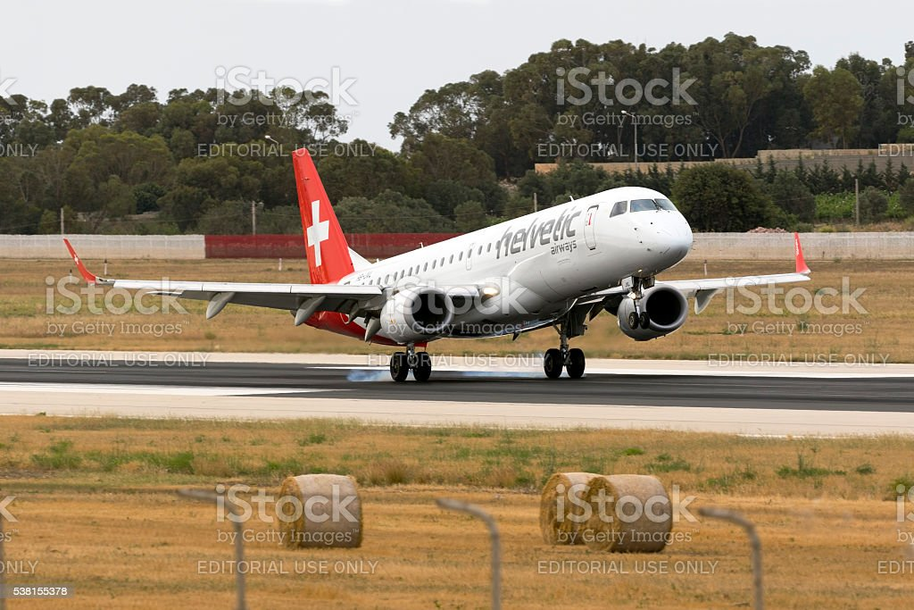 Helvetic Embraer touching down stock photo