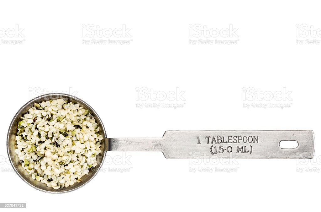 hemp seed hearts in a tablespoon stock photo