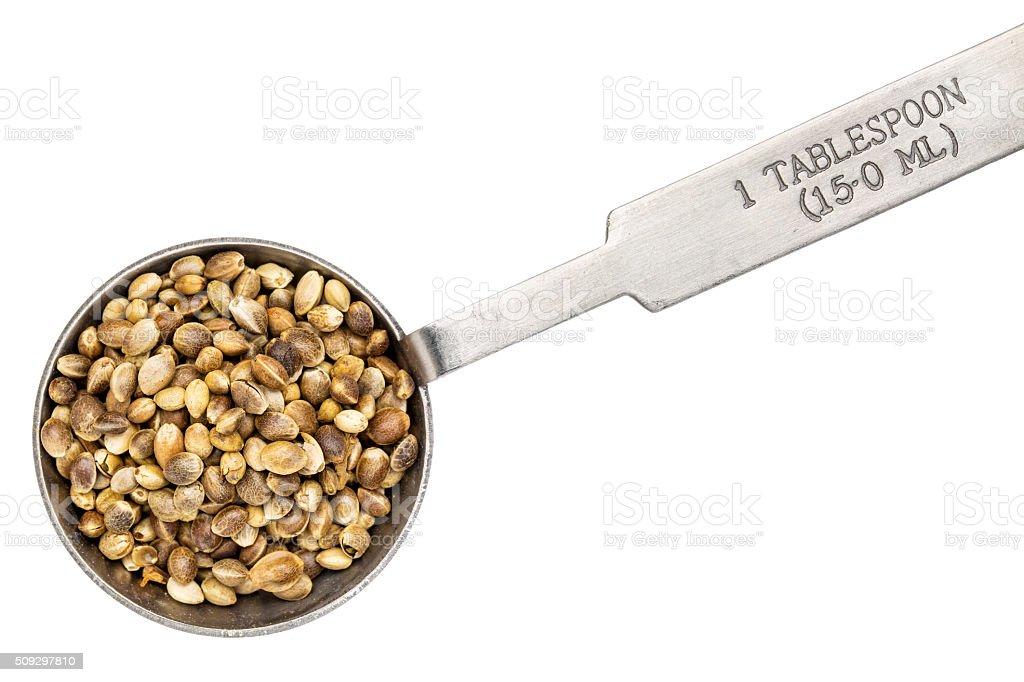 hemp seeds on measuring spoon stock photo