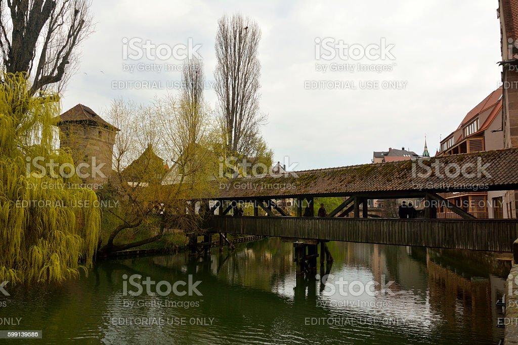 Henkersteg covered bridge across Pegnitz river in Nuremberg stock photo