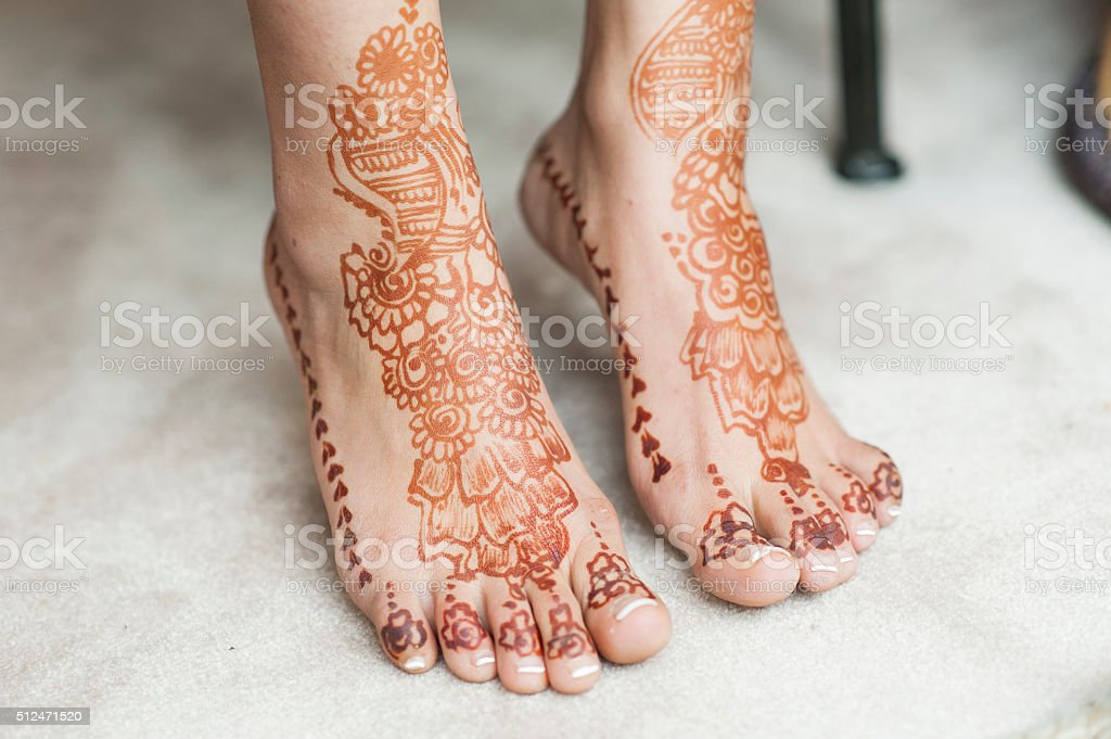 Henna and flowers on bride stock photo