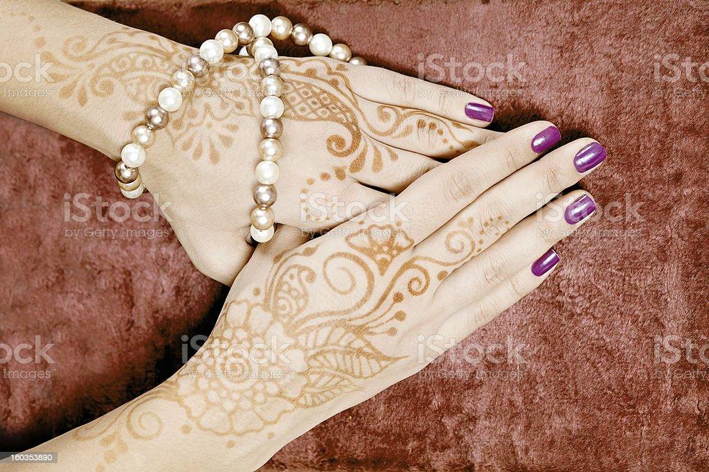 Henna art on woman's hand stock photo