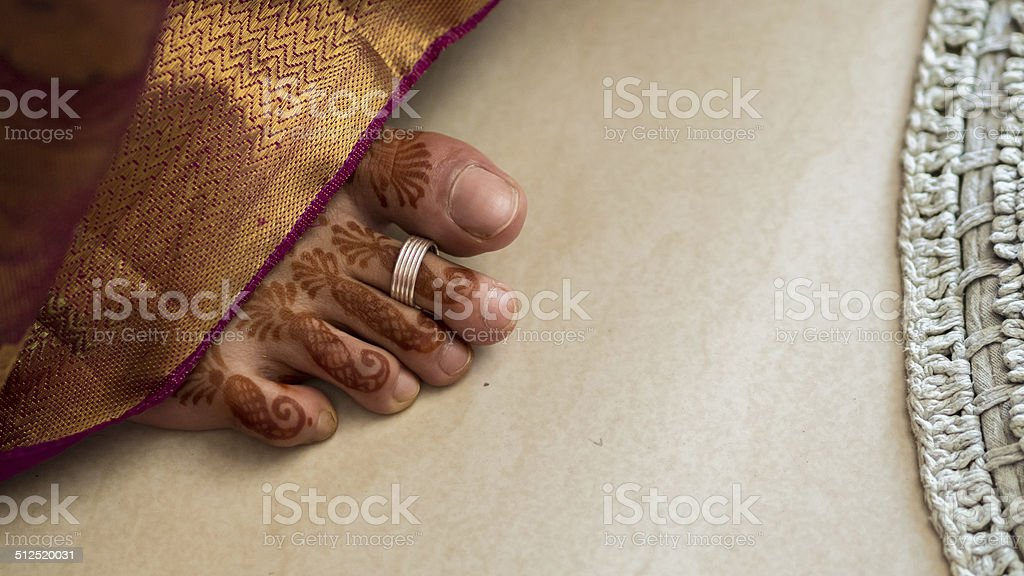 Henna covered south Indian bride's foot stock photo