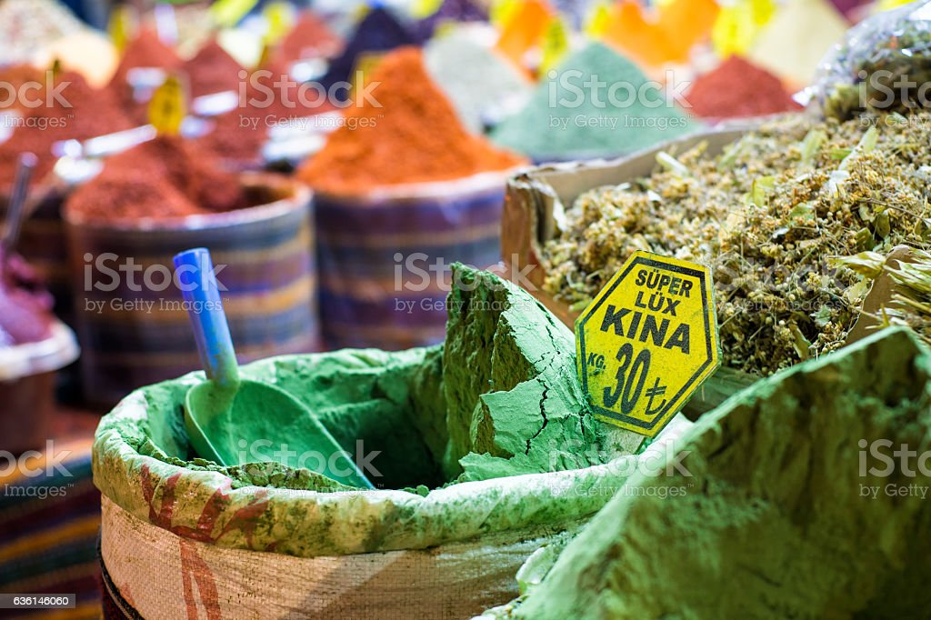 Henna in a sack with colorful spices background stock photo