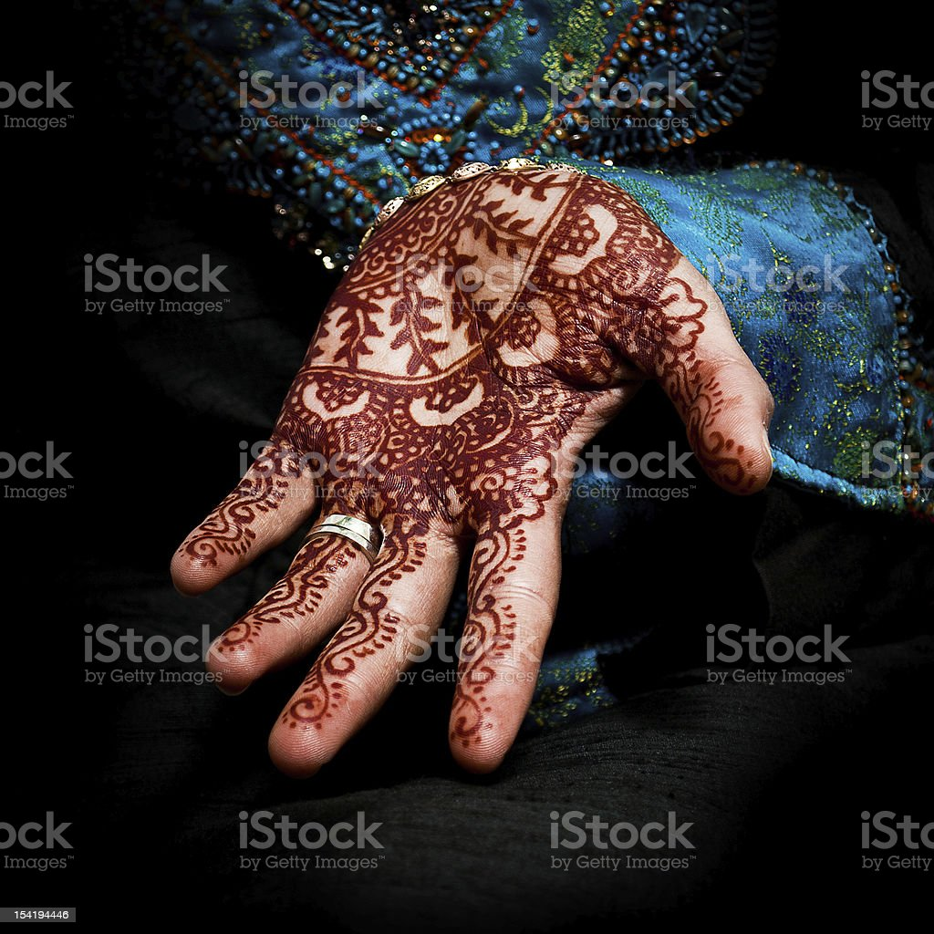 Henna, mehendi on a bride's hand - fun square stock photo