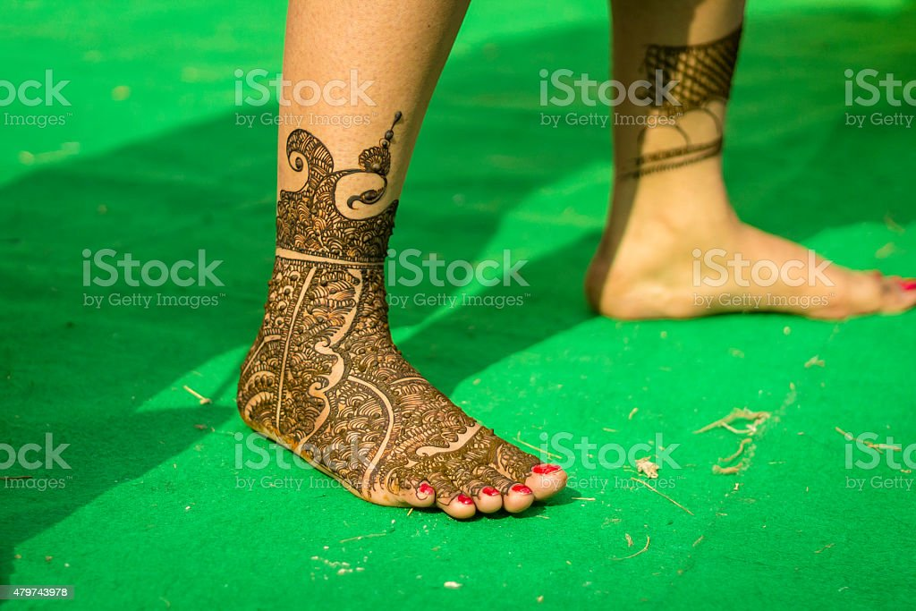 Henna tattoo on the leg of a Indian bride stock photo