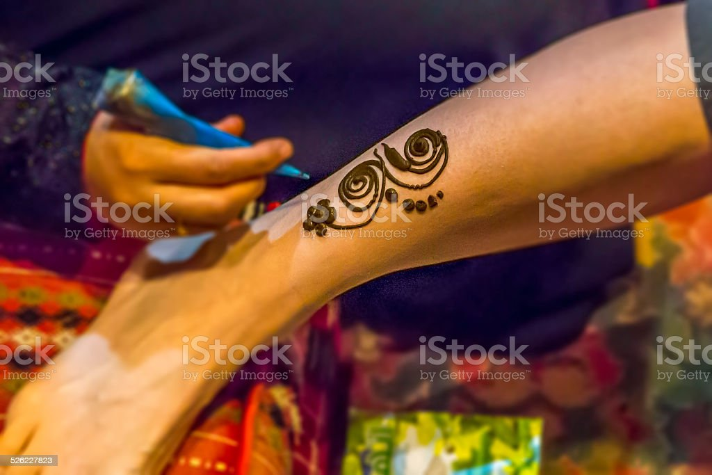 Henne tattoo on leg stock photo