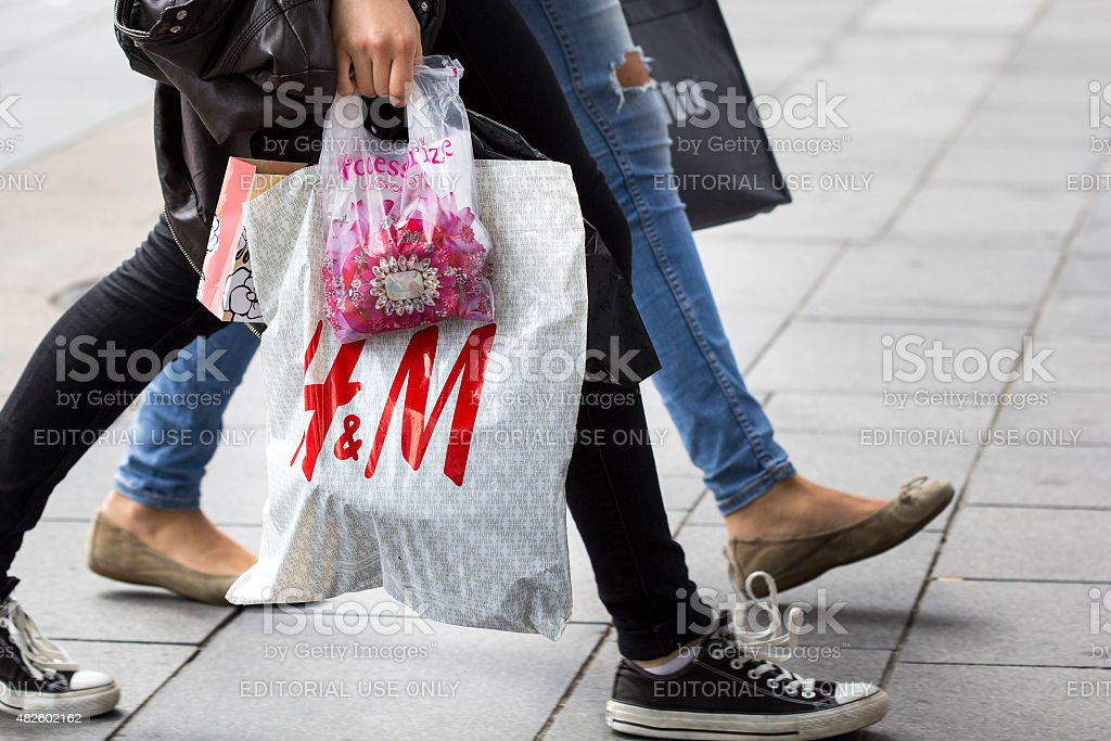 Hennes and Mauritz plastic bag shopping street sale stock photo
