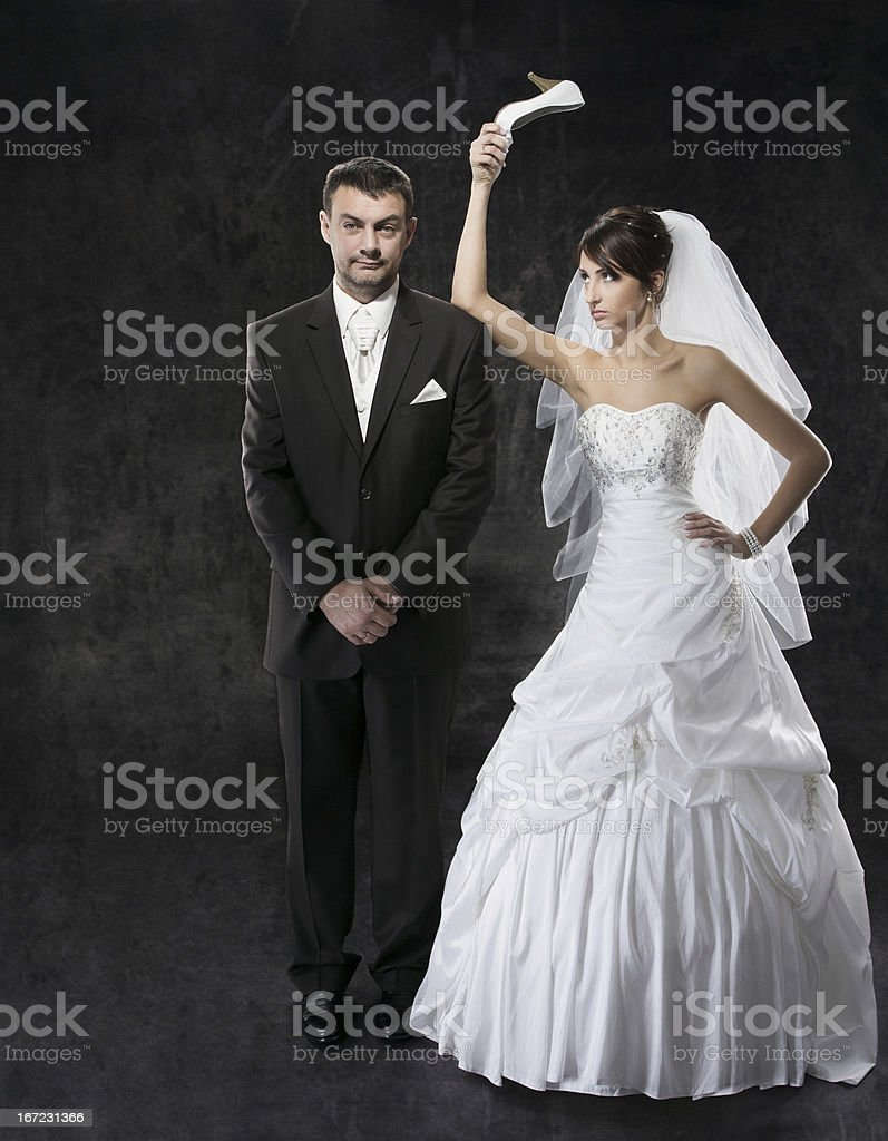 Henpecked, married couple conflict stock photo