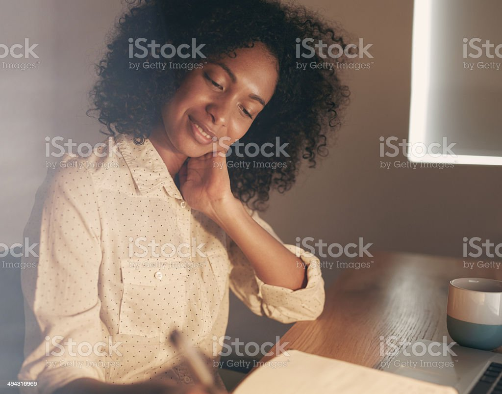 Her best ideas come to her late at night stock photo