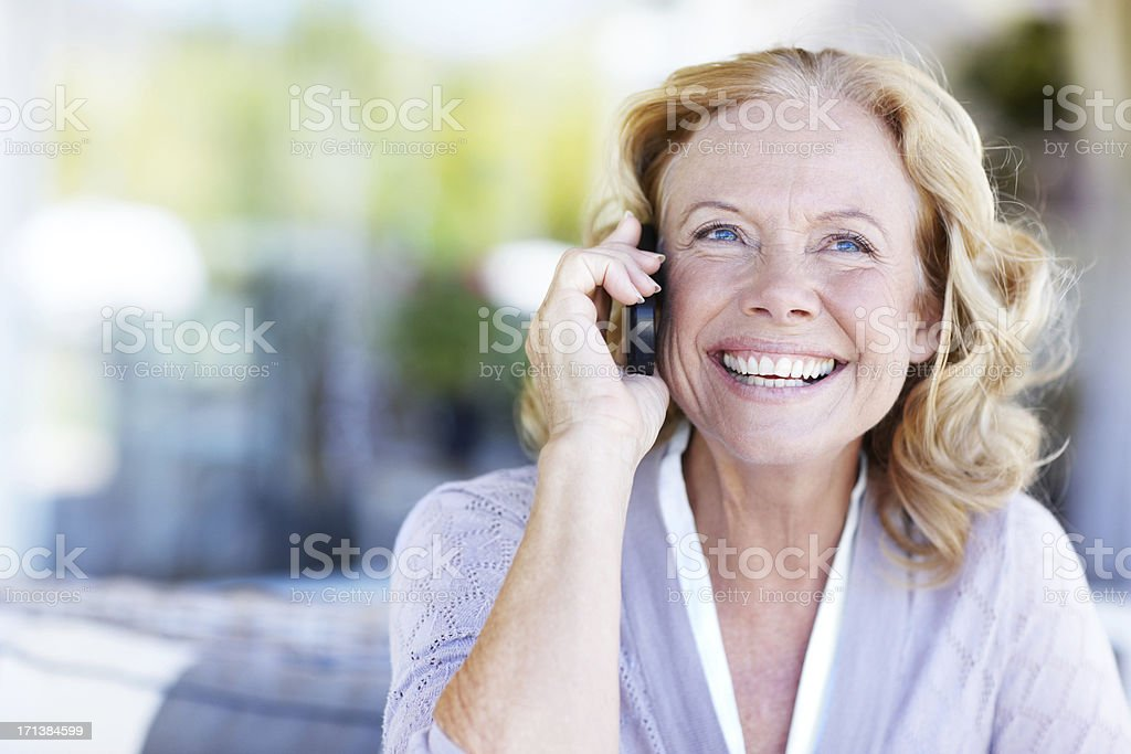 Her cellphone keeping friends and family close stock photo