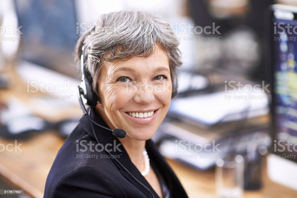 Her clients enjoy her friendly demeanor stock photo