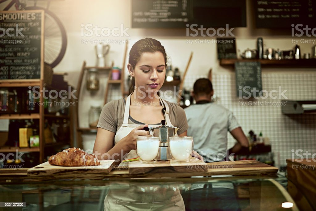 Her coffee making skills don't disappoint stock photo