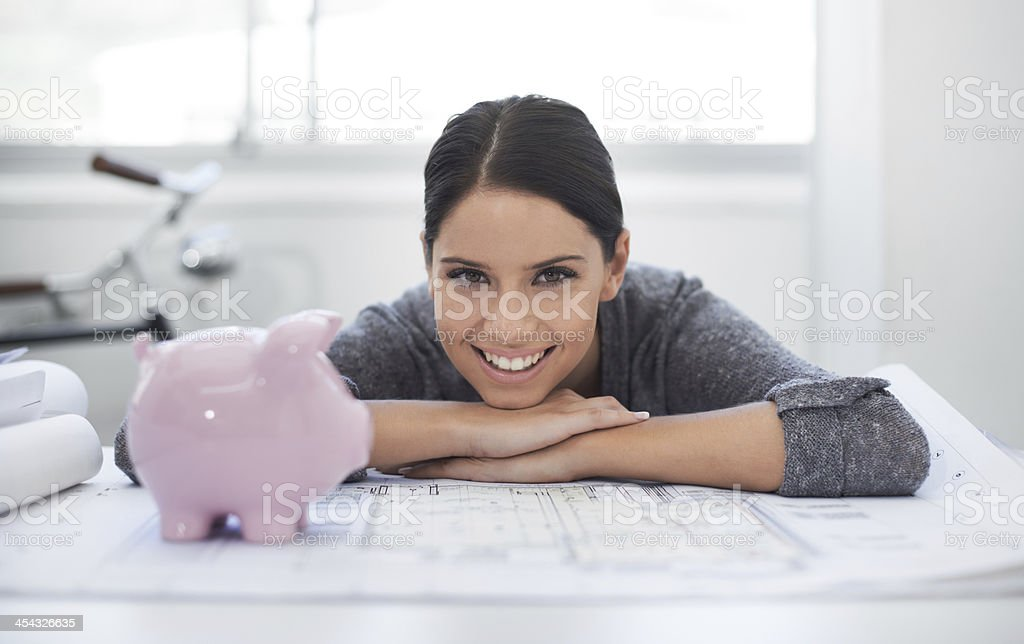 Her company and savings are growing stock photo