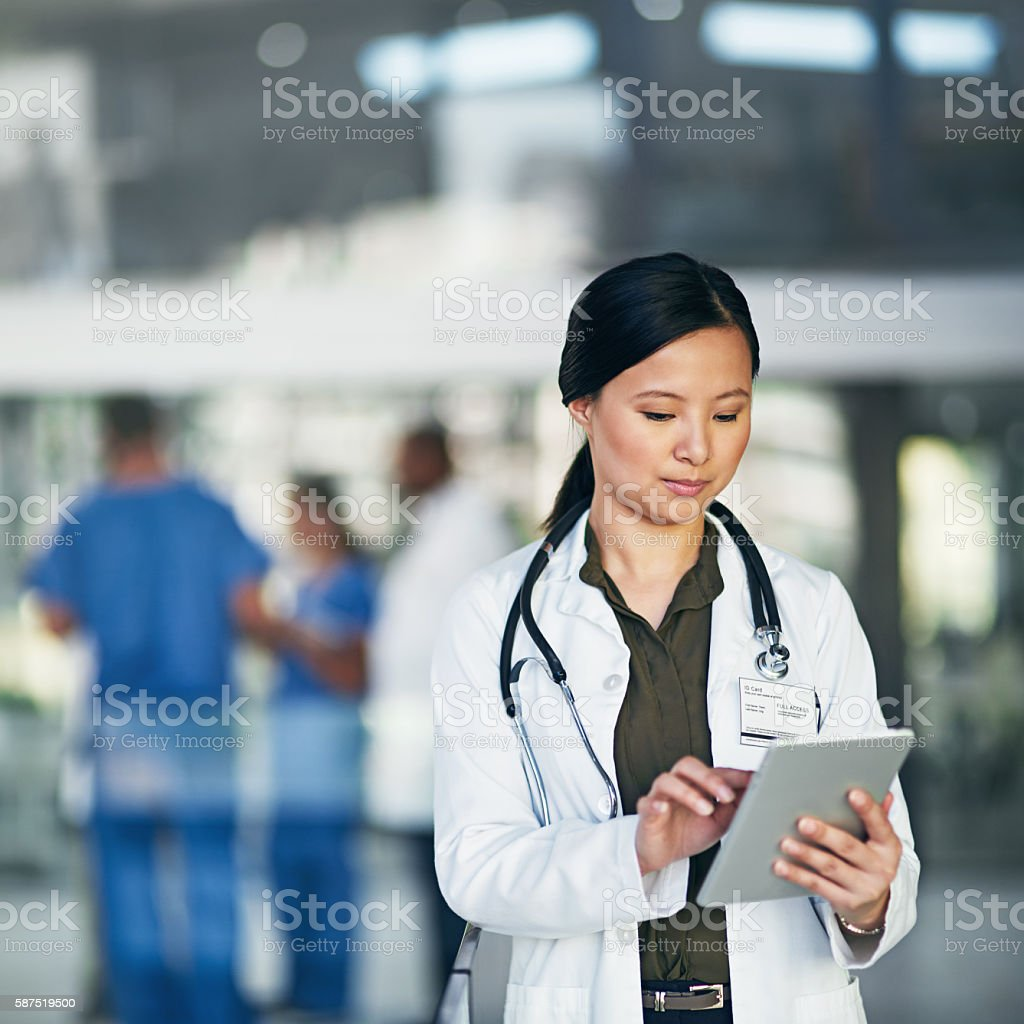 Her connection to patients, doctors and online medical resources stock photo