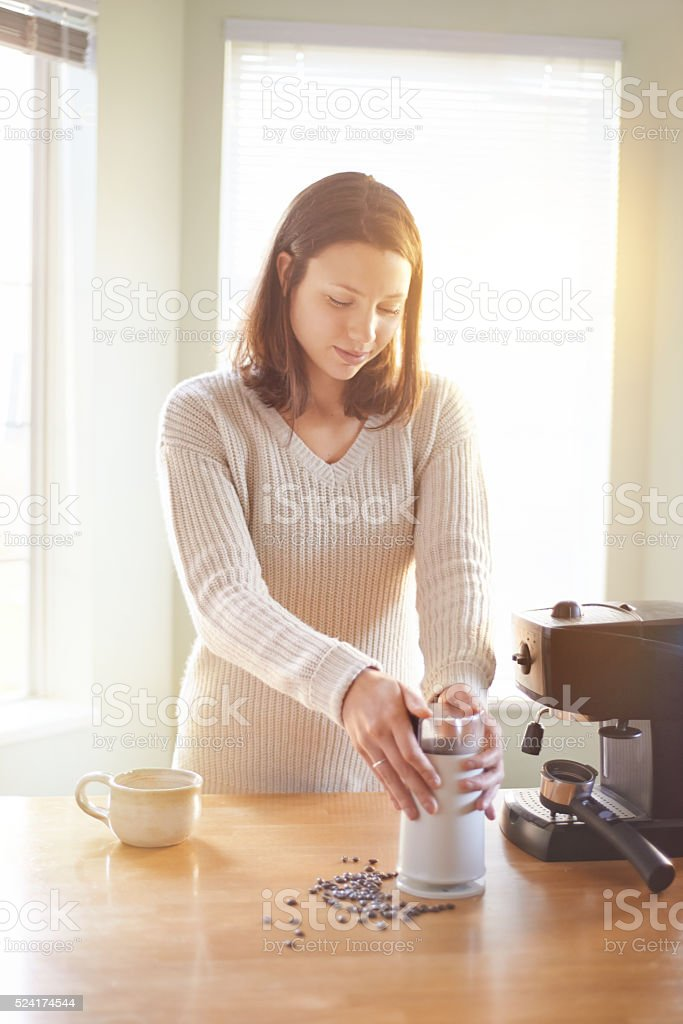 Her day begins with freshly brewed coffee stock photo