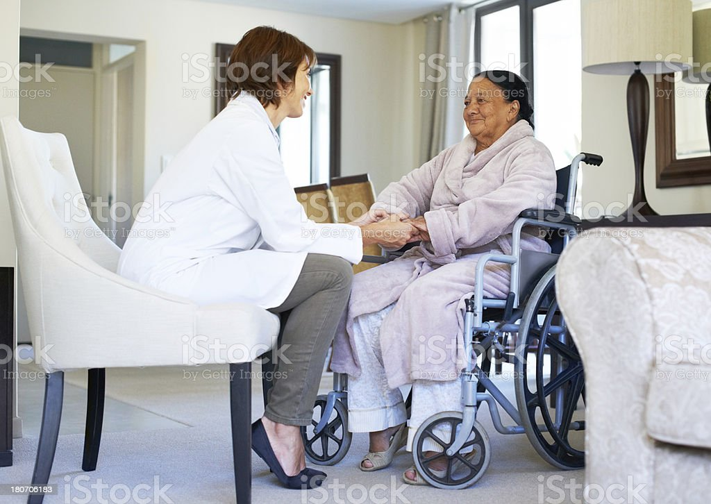 Her doctor provides great reassurance royalty-free stock photo