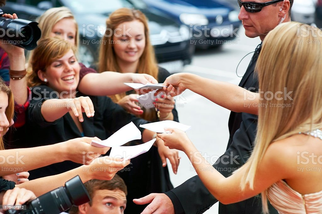 Her fans are fanatical! - In demand stock photo