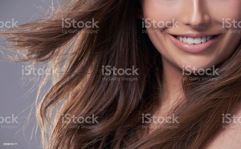 Her gorgeous smile is contagious stock photo
