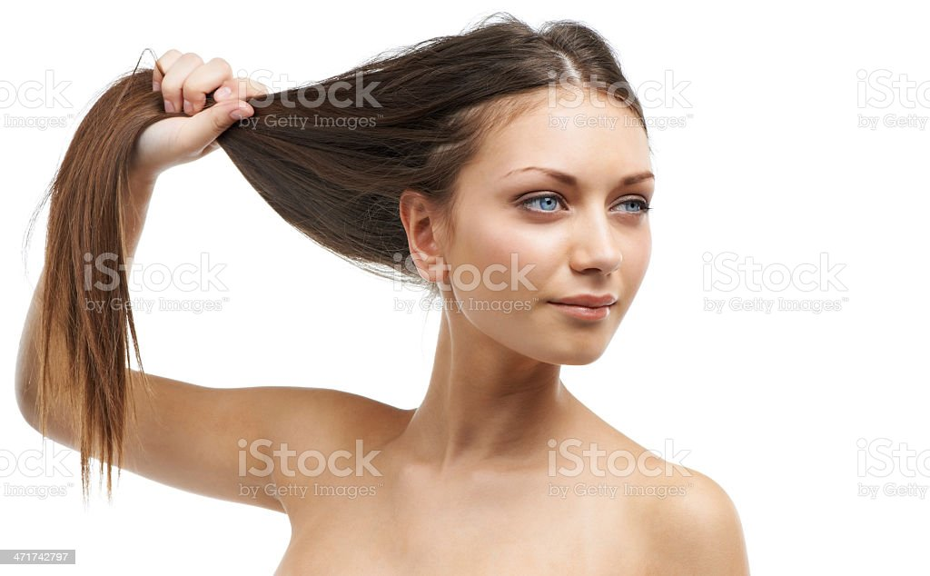Her haircare product is working miracles royalty-free stock photo