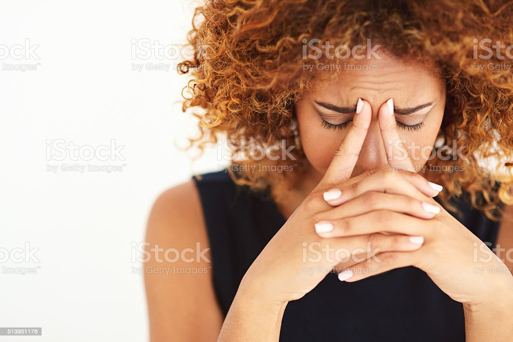 Her head is filled with worries stock photo