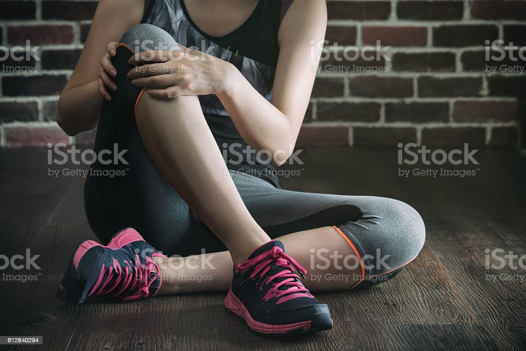 her knee feel painful after fitness exercise, healthy lifestyle stock photo