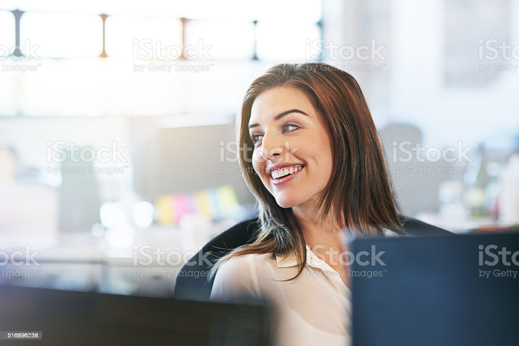 Her positivity brightens up the office stock photo