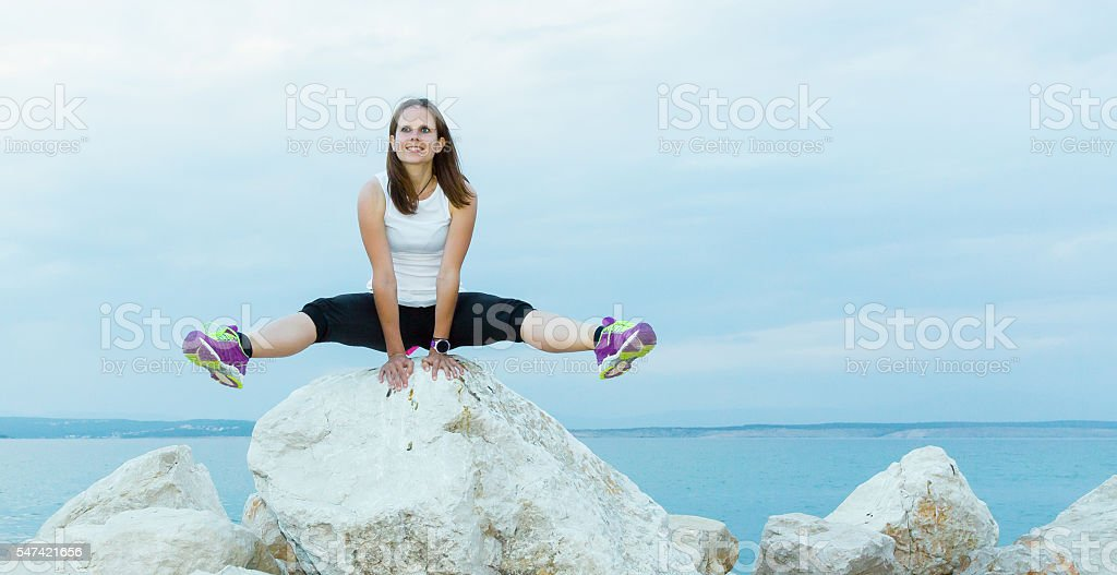 Her seaside workout stock photo