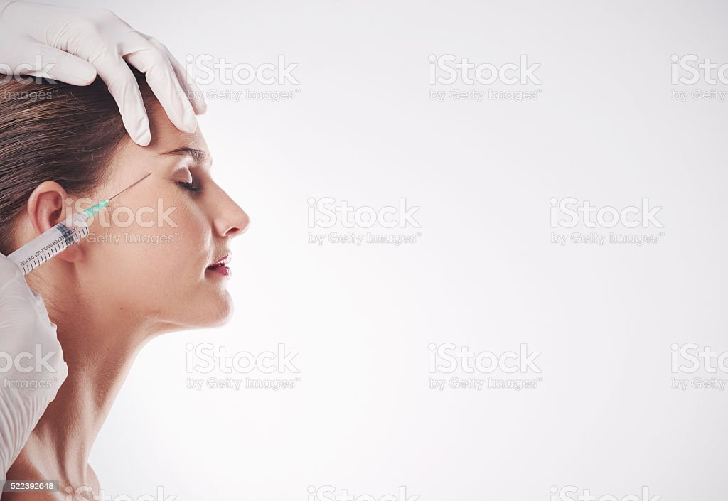 Her secret weapon against the effects of time stock photo