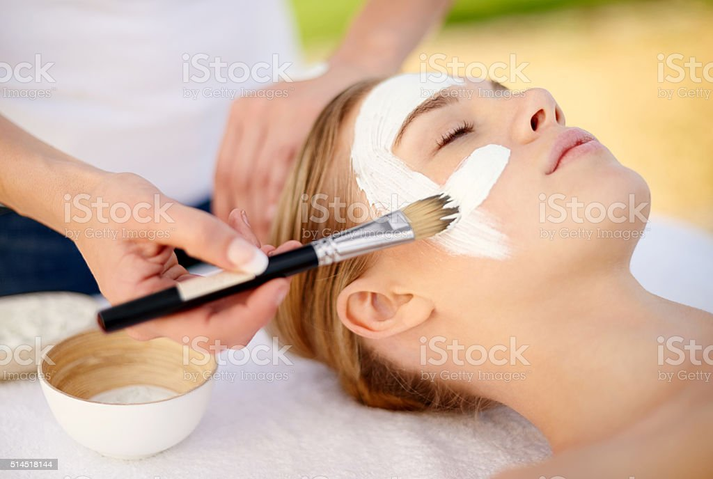 Her skin is getting a brush with greatness stock photo
