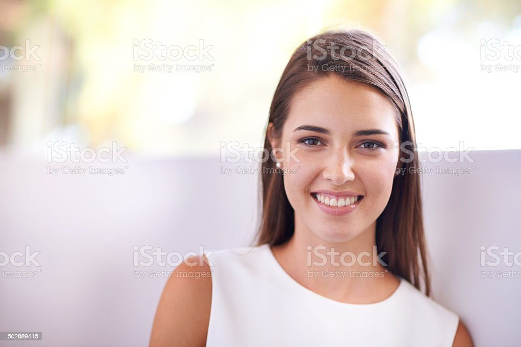 Her smile lights up the room stock photo