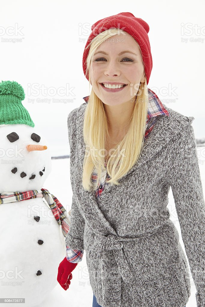 Her smile warming up the winter wonderland royalty-free stock photo