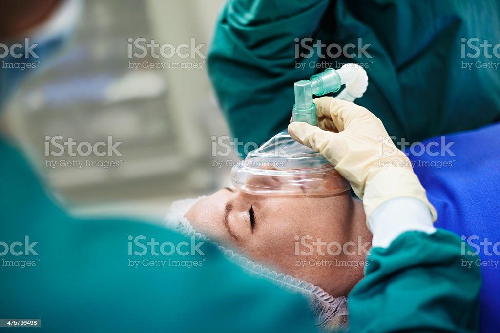 Her surgery is in skilled hands stock photo