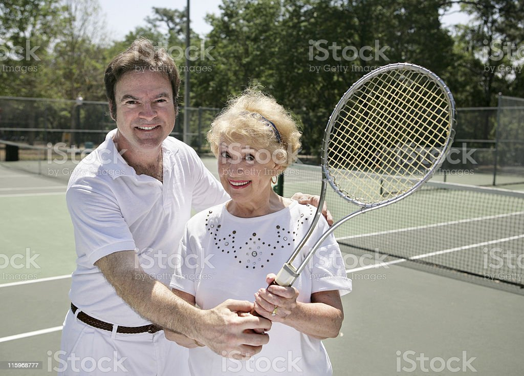 Her Tennis Lesson stock photo